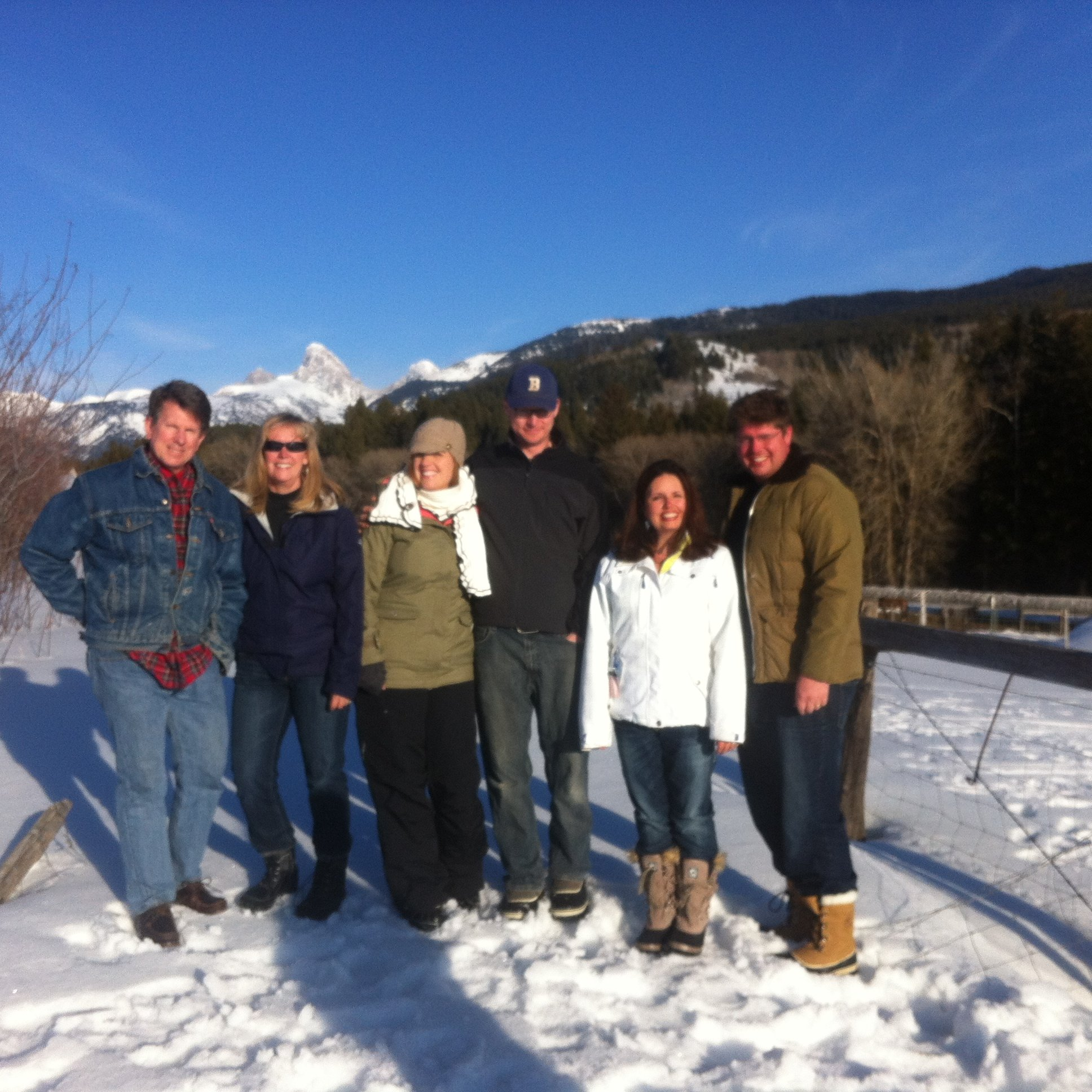 The Partners with Spouses in front of the Tetons